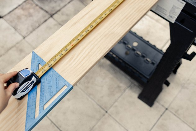 Measuring wood board with a HART tape measure