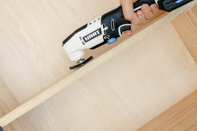 Sanding wood cabinet with HART oscillating multi-tool