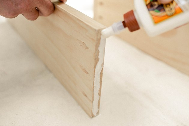 Adding wood glue to the end of wood board