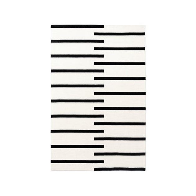 Cream rug with bold black stripes
