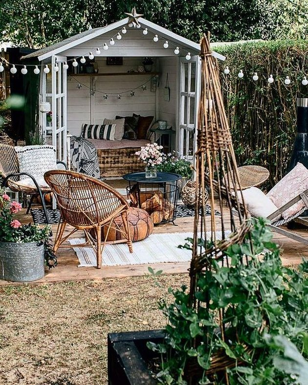 bohemian-inspired she shed in backyard with string lights