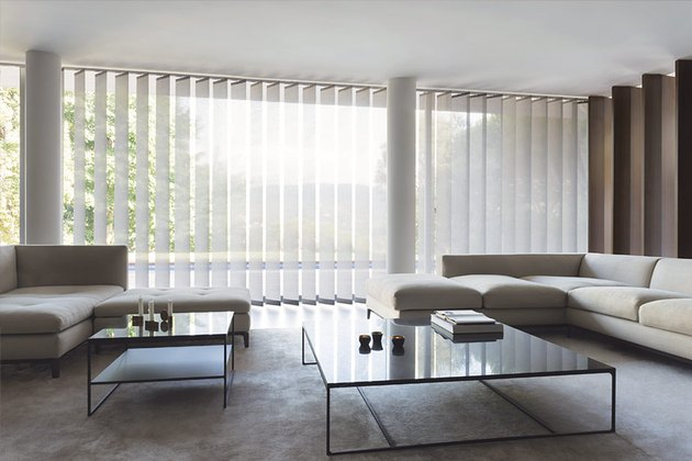 window treatments for sliding glass doors in gray living room with glass coffee tables and two light gray sectionals