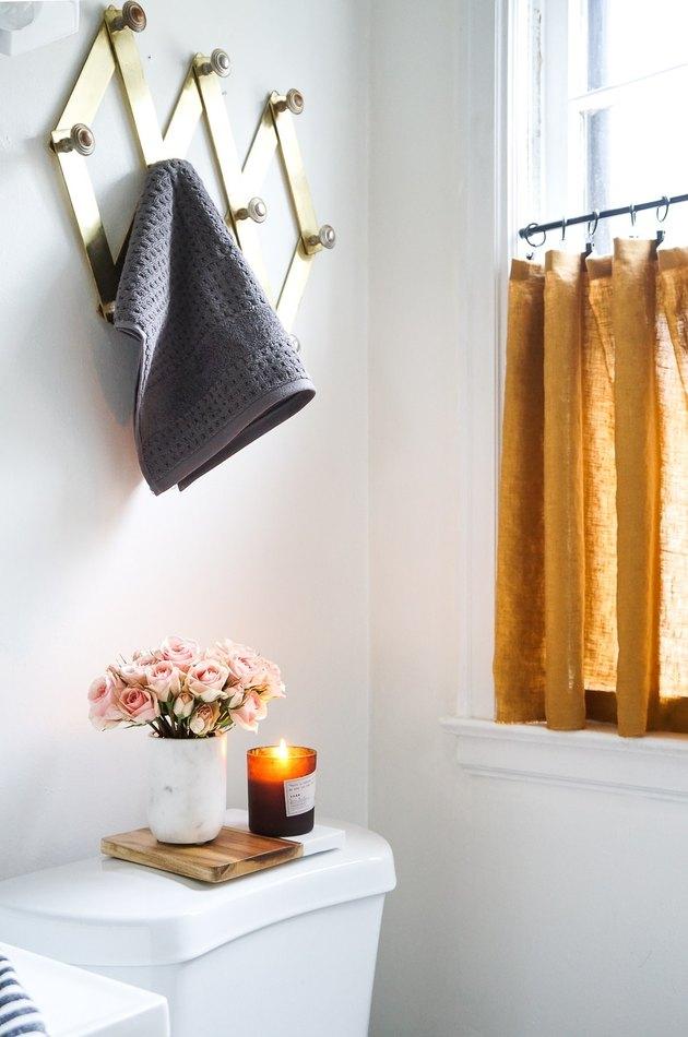 mustard-yellow bathroom curtain idea with cafe curtain in a bathroom window