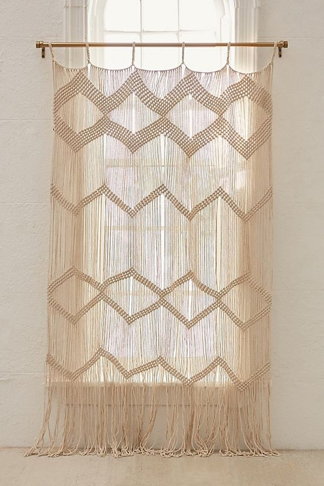 bathroom curtain idea with beige macrame wall hanging used in place of a curtain