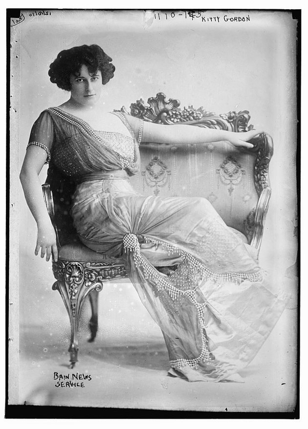 Victorian actress in an ornate loveseat