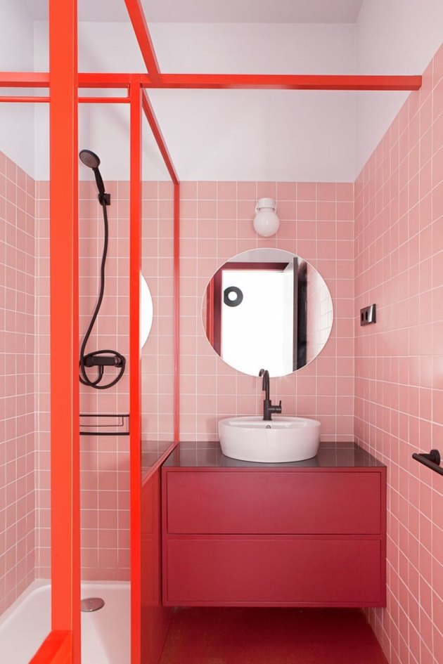 colors that go with red, blush tile bathroom with red accents