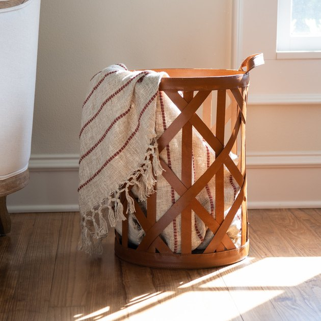 leather strap basket with striped blanket
