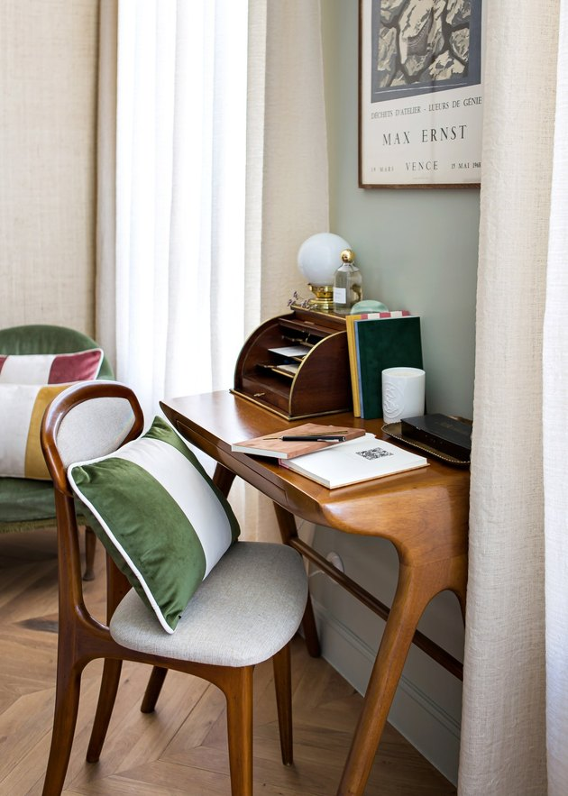 desk space with green pillow on chair