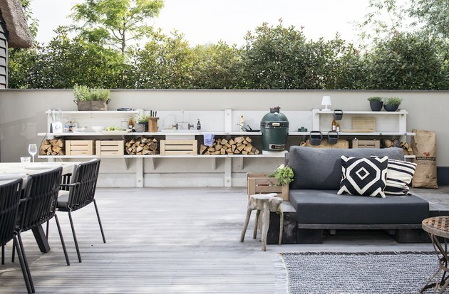 concrete sectional outdoor kitchen idea with chopped wood