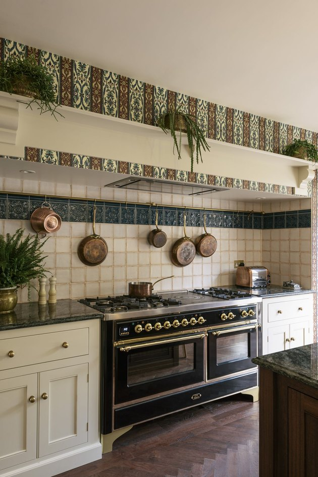 ornate arts and crafts kitchen with patterned tile