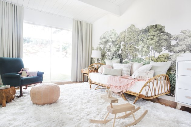 girls bedroom idea with rattan daybed and tree mural