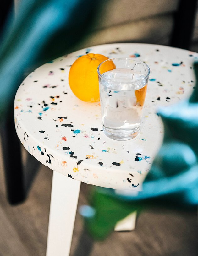white patterned table with glass and orange