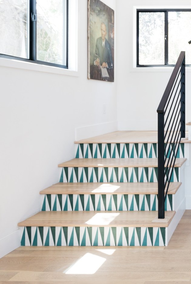 stairs decoration with blue and white tile and vintage painting on wall