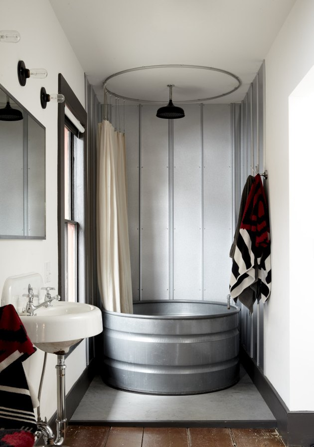 rustic industrial decor in bathroom with metal tub