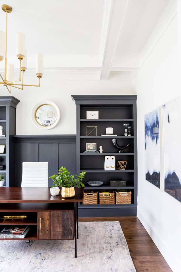 white home office with charcoal color built-in bookshelves