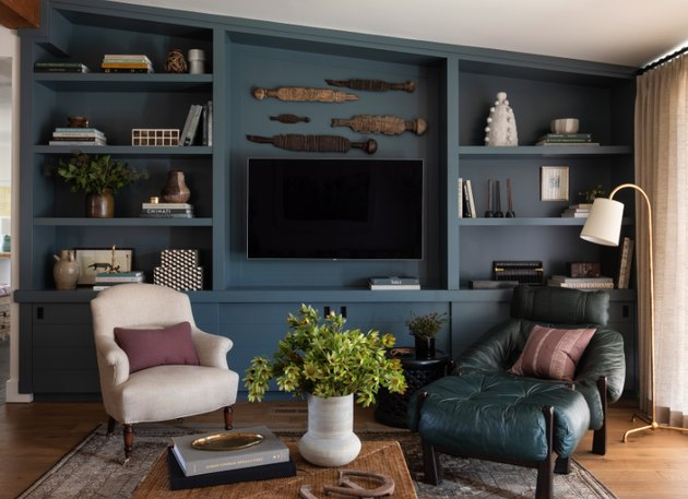Moody blue media cabinet with wall-mounted flat screen