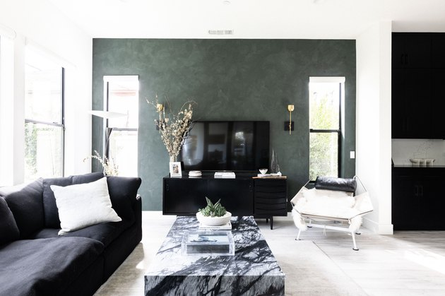 colors that go with green, green accent wall with black furniture