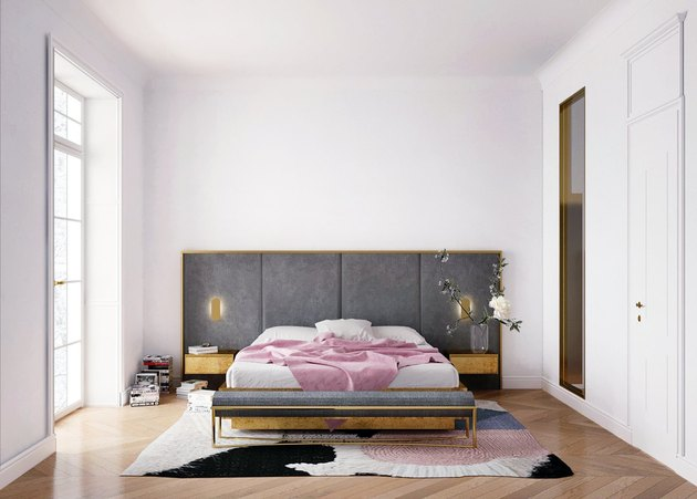 white bedroom with charcoal color headboard and large bed
