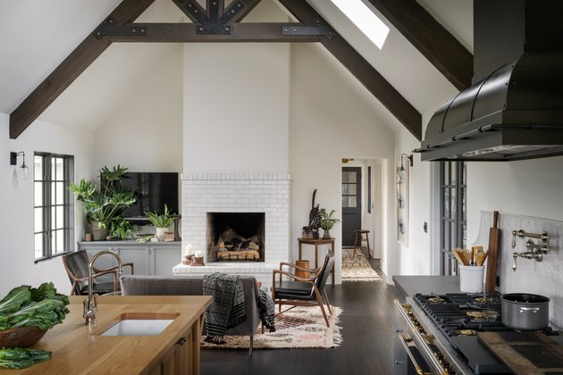 living room TV idea with plants and A-frame ceiling