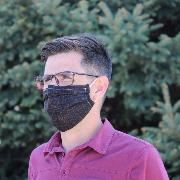 person wearing face mask and glasses
