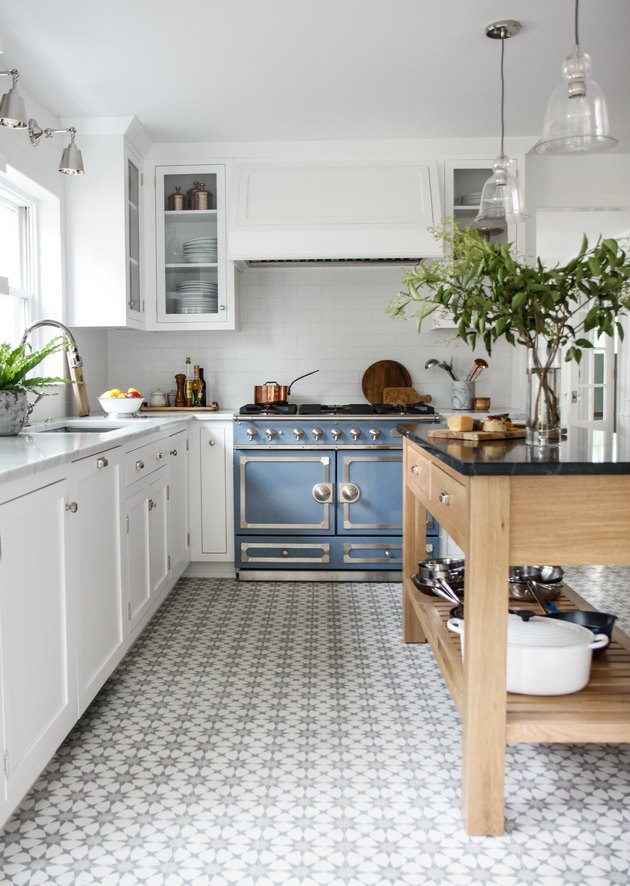 Kitchen floor tile idea with white cabinets and wood island