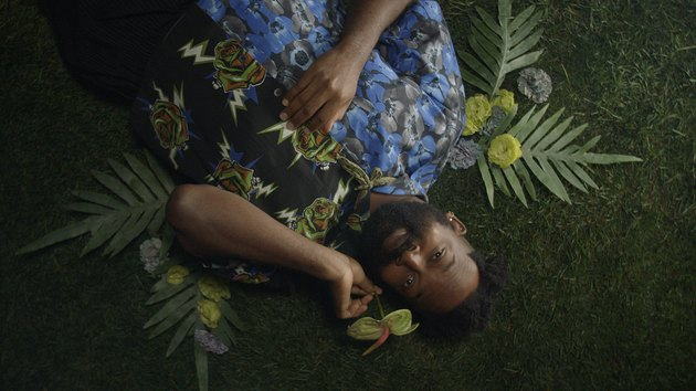maurice harris with flowers around him