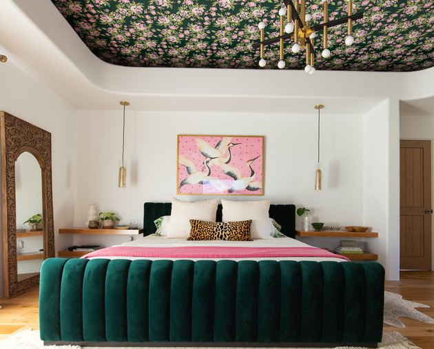 maximalist bedroom with jewel-tones and wallpaper on ceiling
