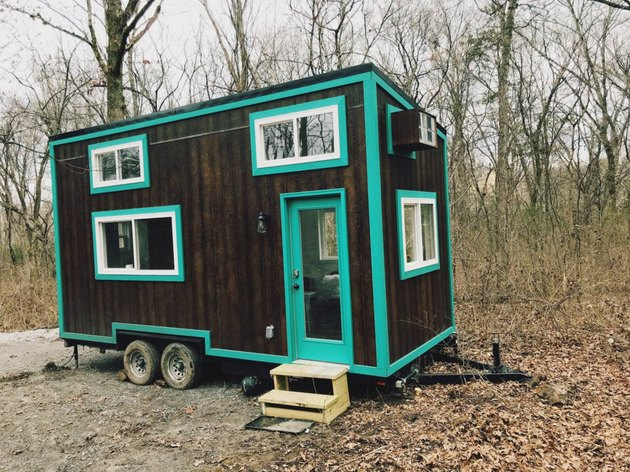 Tiny cabin with teal trim.