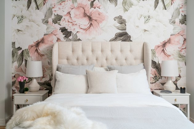 Small bedroom decorating idea with bold floral wallpaper