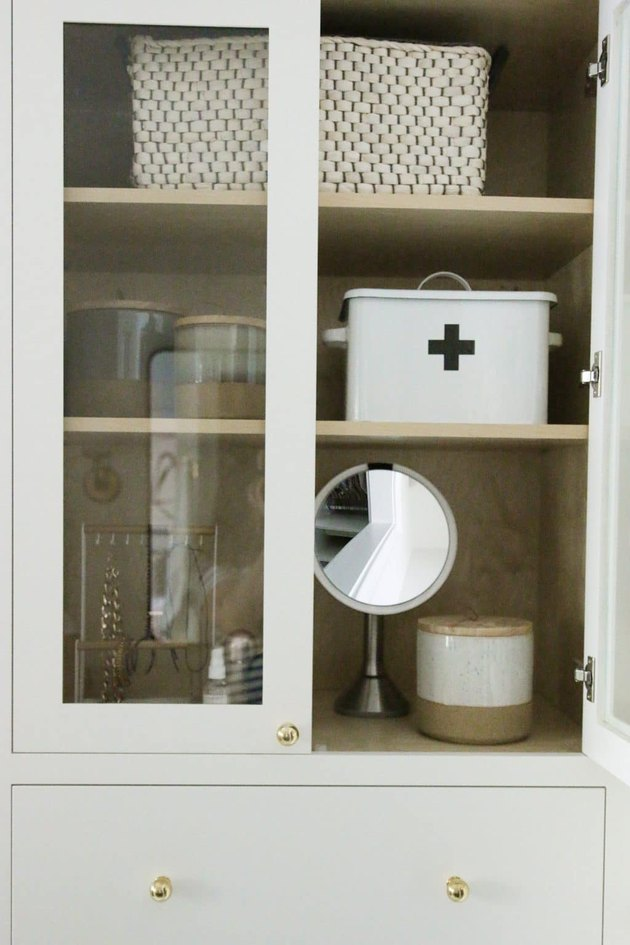 Bathroom organization idea with white cabinet