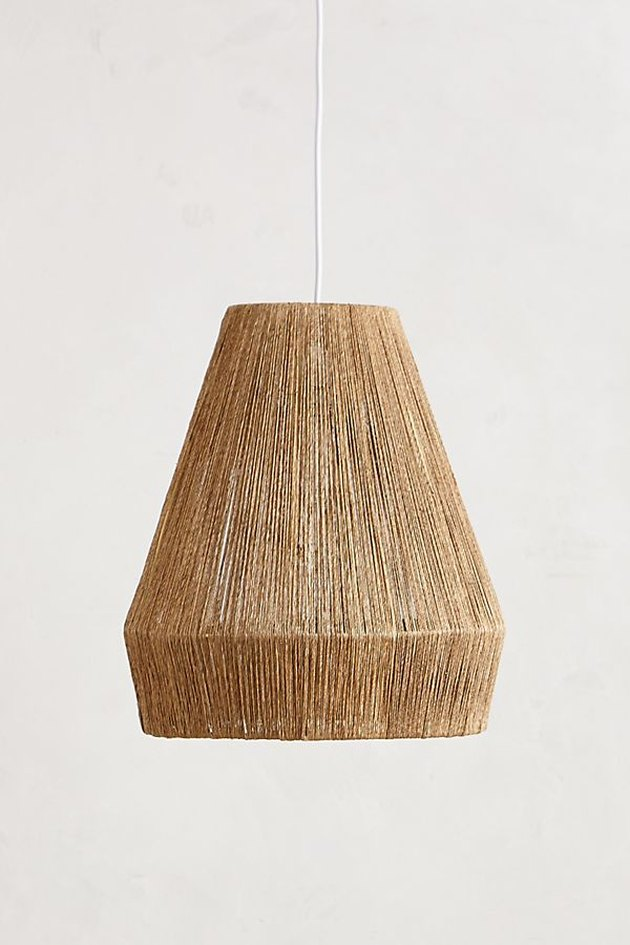 Tan finely-woven bell-shaped pendant light