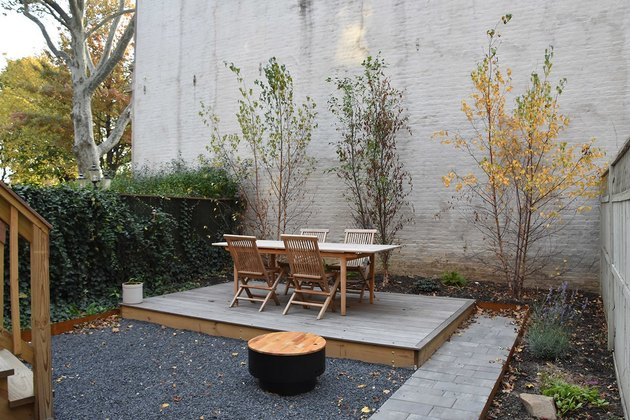 Simple plantings and natural surfaces are modern farmhouse characteristics.