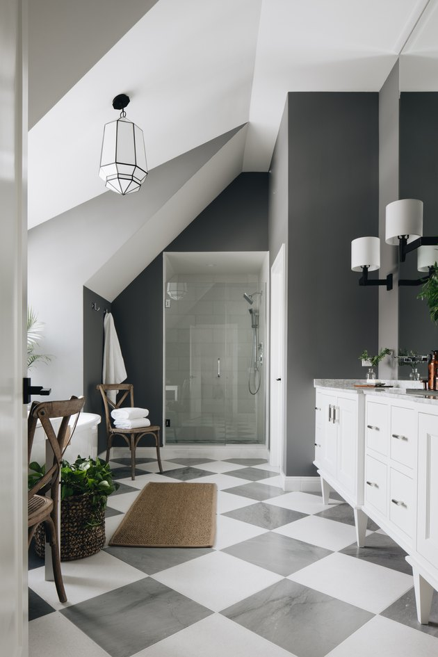 bathroom with charcoal color on walls and floor tile