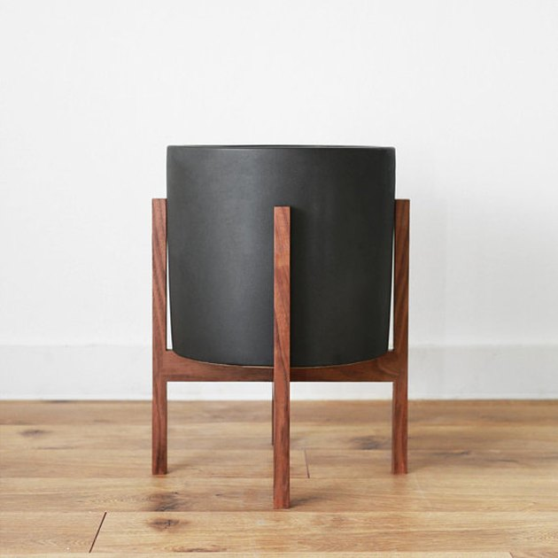 Black mid-century planter with wooden frame