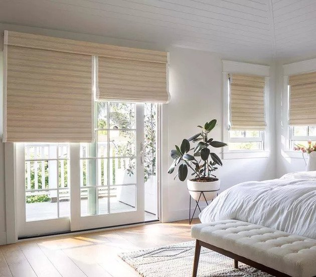 window treatments for sliding glass doors in white bedroom with plant
