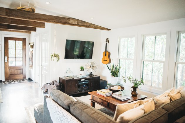 Bohemian living room idea with exposed wood beams and comfy sofas