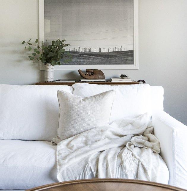 Slipcovered sofa in white modern living room