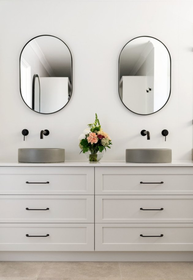 Gray concrete sink idea with gray vanity cabinet and black fixtures