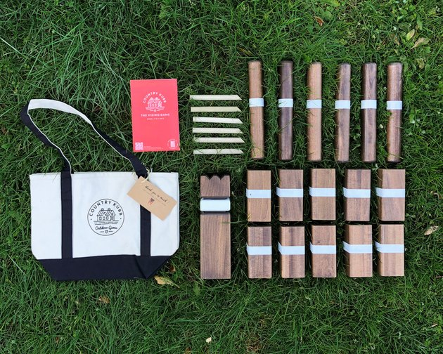 A Kubb set against a lawn.