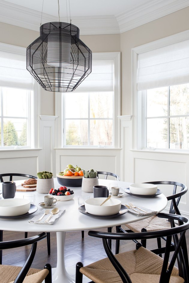 Breakfast dining nook with bright white folding bay window curtains