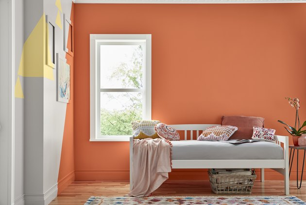 room with orange wall and a couch