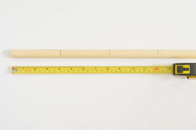 Wooden dowel and tape measure