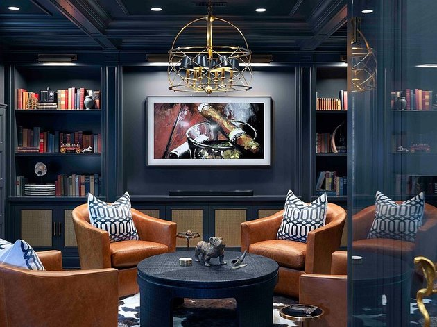 dark blue rustic man cave ideas with cigar photo and leather chairs
