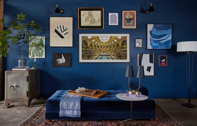 blue paint color in living room wall with gallery wall and daybed