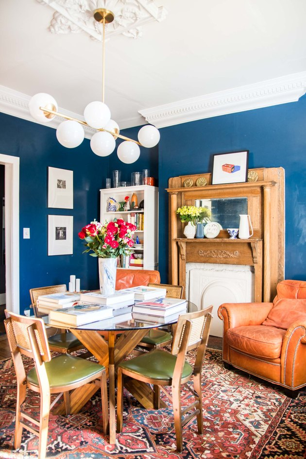 blue paint color in dining room with fireplace and dining room table