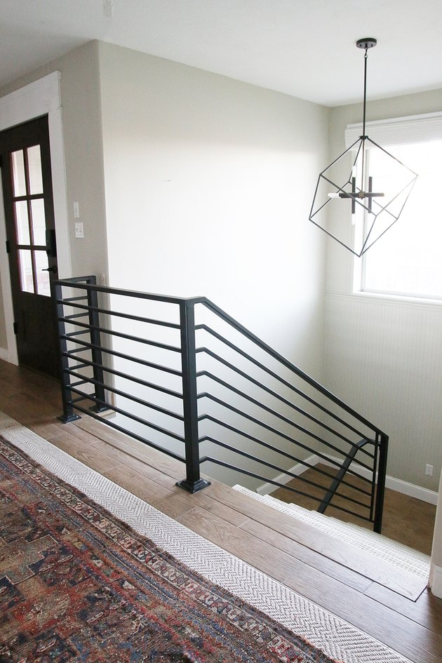 modern black stair railing with pendant