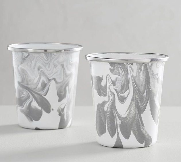 two enamel gray and white tumblers
