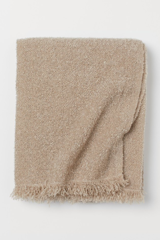 beige bouclé throw