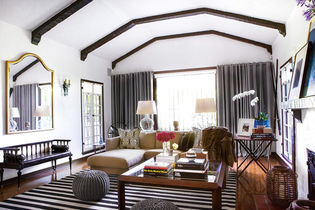 white living room with exposed beams and rustic glam decor