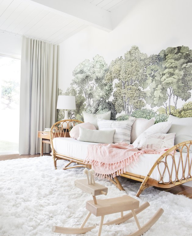 Blush and green nursery with sage color trees on wallpaper